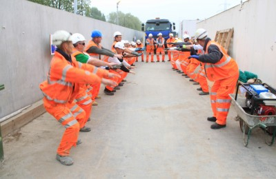 Photo of Crossrail workers on a worksite exercising