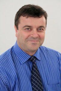 Photo of John Comins