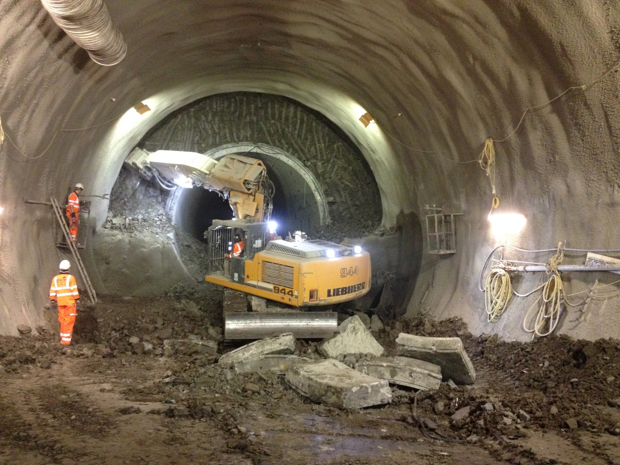 Figure 20: Excavation of top heading during enlargement of precast concrete pilot tunnel to full platform size (11m wide x 10m high).