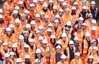 Photo of large group of Crossrail workers on a worksite