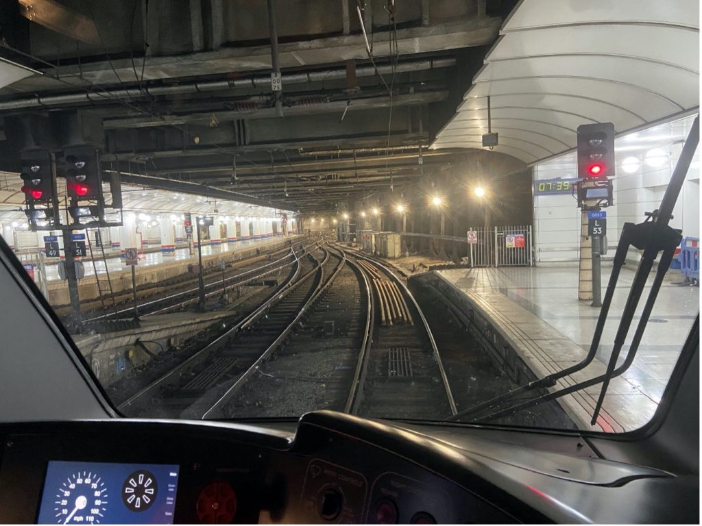 View from train cab of country end of platform 18 at Liverpool Street and tracks in station throat